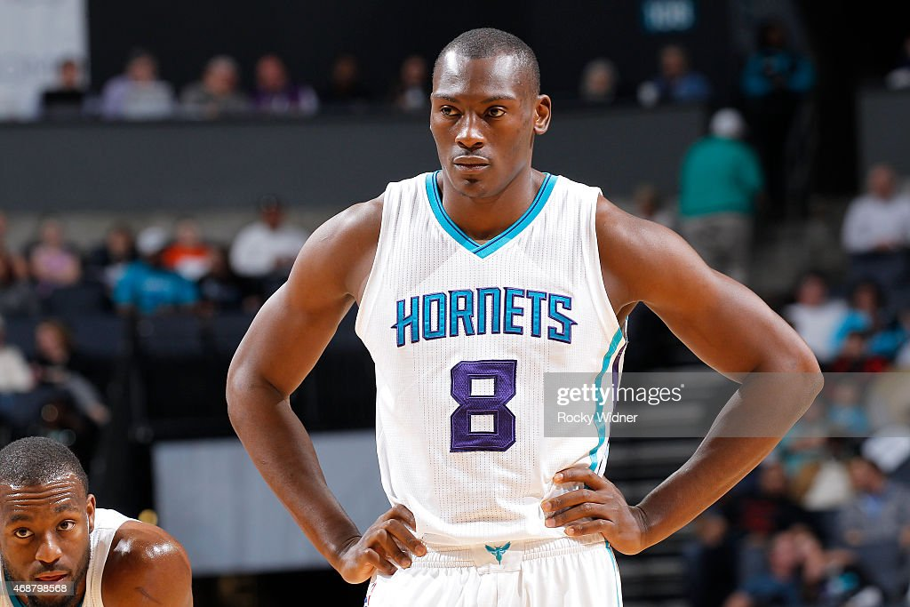 Bismack Biyombo of the Charlotte Hornets looks on during the game against the Detroit Pistons on April 1 2015 at Time Warner Cable Arena in Charlotte...