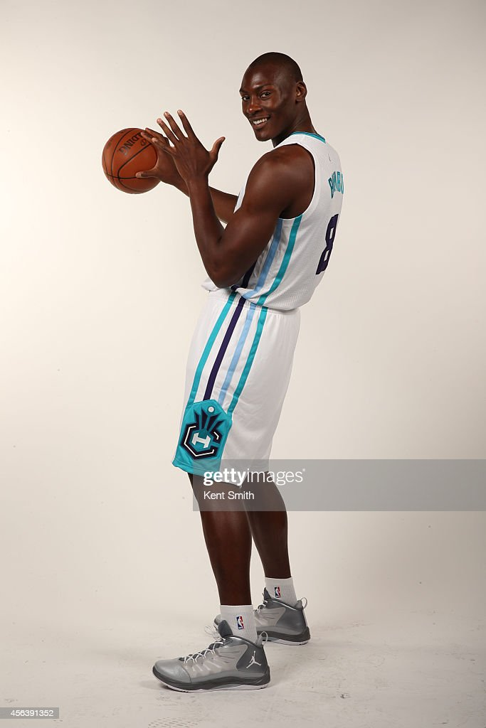 Bismack Biyombo of the Charlotte Hornets pose for their 1st ever media day at Time Warner Cable Arena on September 29 2014 in Charlotte North...