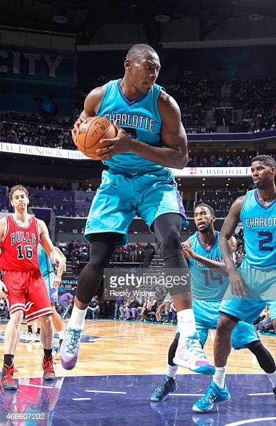Bismack Biyombo of the Charlotte Hornets rebounds against the Chicago Bulls on March 13 2015 at Time Warner Cable Arena in Charlotte North Carolina...
