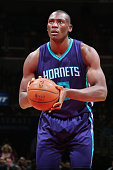 Bismack Biyombo of the Charlotte Hornets shoots against the Washington Wizards during the game on March 27 2015 at Verizon Center in Washington DC...