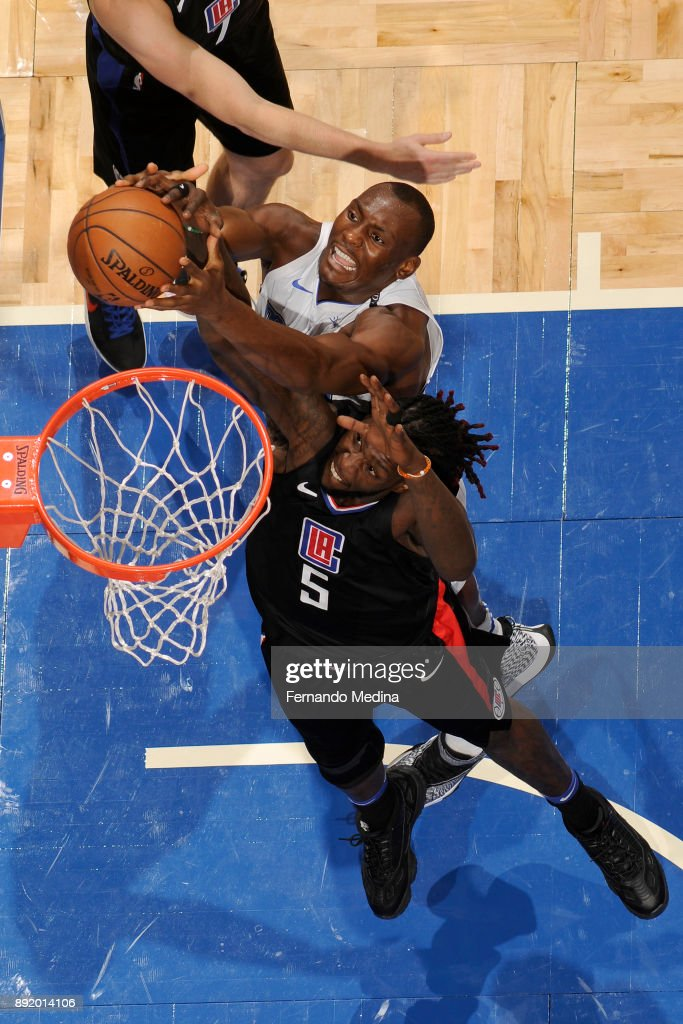 Bismack Biyombo #11 of the Orlando Magic and Montrezl Harrell #5 of the LA Clippers battle for ball during the game on December 13, 2017 at Amway Center in Orlando, Florida.
