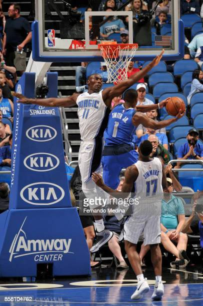Bismack Biyombo of the Orlando Magic goes for the block agaiinst Dennis Smith Jr #1 of the Dallas Mavericks during a preseason game on October 5 2017...