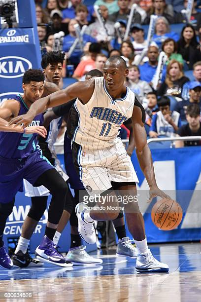 Bismack Biyombo of the Orlando Magic handles the ball against the Charlotte Hornets during the game on December 28 2016 at Amway Center in Orlando...