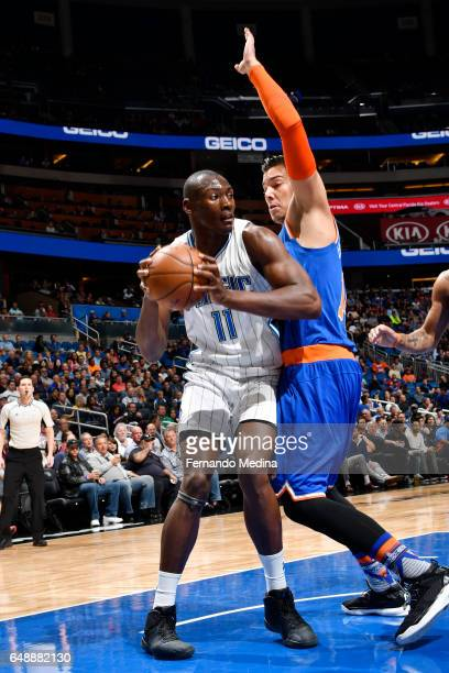 Bismack Biyombo of the Orlando Magic handles the ball against Willy Hernangomez of the New York Knicks during the game on March 6 2017 at Amway...
