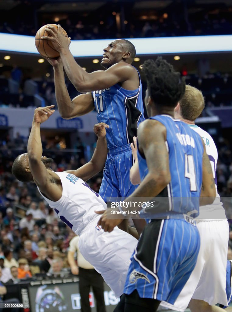Bismack Biyombo #11 of the Orlando Magic runs into Kemba Walker #15 of the Charlotte Hornets during their game at Spectrum Center on March 10, 2017 in Charlotte, North Carolina.