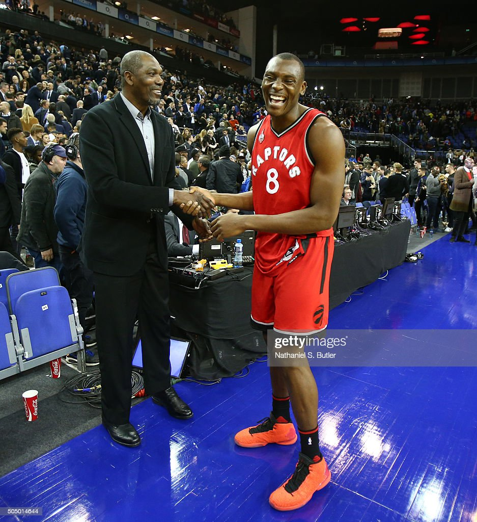 <a gi-track='captionPersonalityLinkClicked' href=/galleries/search?phrase=Bismack+Biyombo&family=editorial&specificpeople=7640443 ng-click='$event.stopPropagation()'>Bismack Biyombo</a> #8 of the Toronto Raptors and NBA Legend <a gi-track='captionPersonalityLinkClicked' href=/galleries/search?phrase=Hakeem+Olajuwon&family=editorial&specificpeople=202637 ng-click='$event.stopPropagation()'>Hakeem Olajuwon</a> shake hands during the game between the Orlando Magic and the Toronto Raptors as part of the 2016 Global Games London on January 14, 2016 at The O2 Arena in London, England.