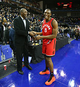 Bismack Biyombo of the Toronto Raptors and NBA Legend Hakeem Olajuwon shake hands during the game between the Orlando Magic and the Toronto Raptors...