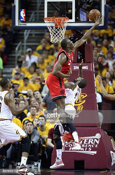 Bismack Biyombo of the Toronto Raptors blocks a shot by Kyrie Irving of the Cleveland Cavaliers during the first half in game two of the Eastern...