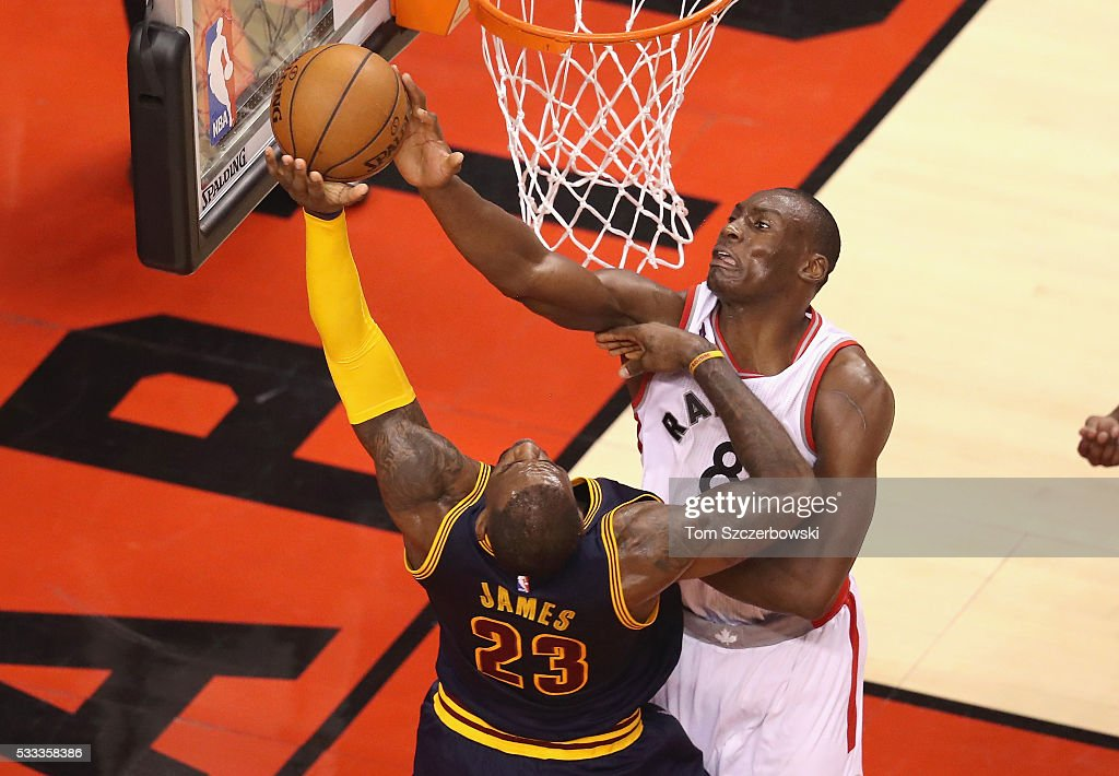 Bismack Biyombo of the Toronto Raptors blocks a shot by LeBron James of the Cleveland Cavaliers and is called for a foul during the second half in...
