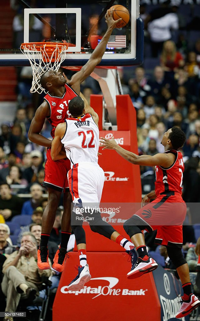 Bismack Biyombo of the Toronto Raptors blocks the shot of Otto Porter Jr #22 of the Washington Wizards in the first half at Verizon Center on January...