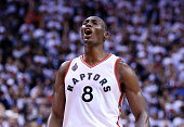 Bismack Biyombo of the Toronto Raptors celebrates late in the second half of Game Seven of the Eastern Conference Quarterfinals against the Miami...