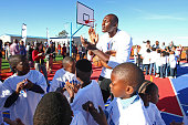 Bismack Biyombo of the Toronto Raptors claps his hands during the Boys Girls Club of Protea Glen court dedication as part the Basketball Without...