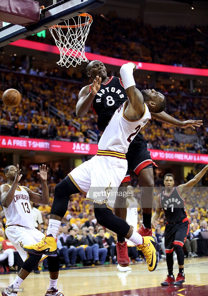Bismack Biyombo #8 of the Toronto Raptors collides with LeBron James #23 of the Cleveland Cavaliers in the third quarter in game one of the Eastern Conference Finals during the 2016 NBA Playoffs at Quicken Loans Arena on May 17, 2016 in Cleveland, Ohio.