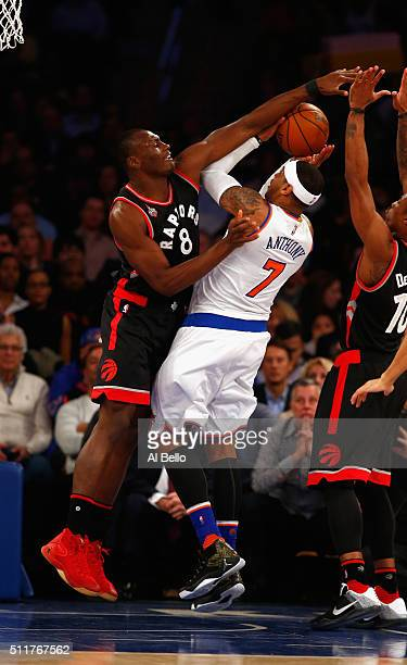 Bismack Biyombo of the Toronto Raptors defends against Carmelo Anthony of the New York Knicks during their game at Madison Square Garden on February...
