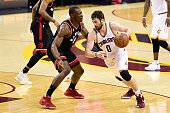 Bismack Biyombo of the Toronto Raptors defends Kevin Love of the Cleveland Cavaliers in the first half in game five of the Eastern Conference Finals...