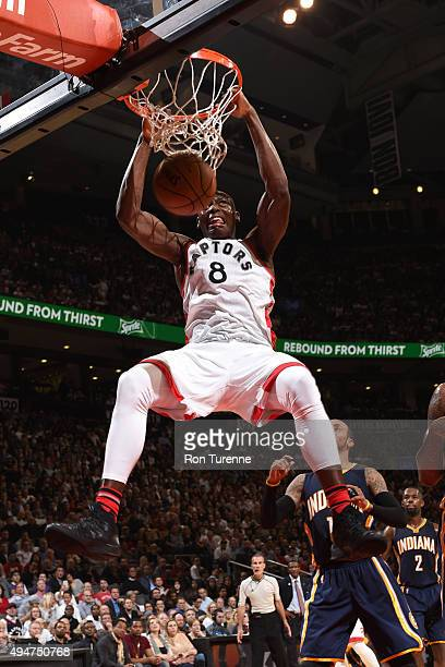 Bismack Biyombo of the Toronto Raptors dunks the ball against the Indiana Pacers on October 28 2015 at the Air Canada Centre in Toronto Ontario...
