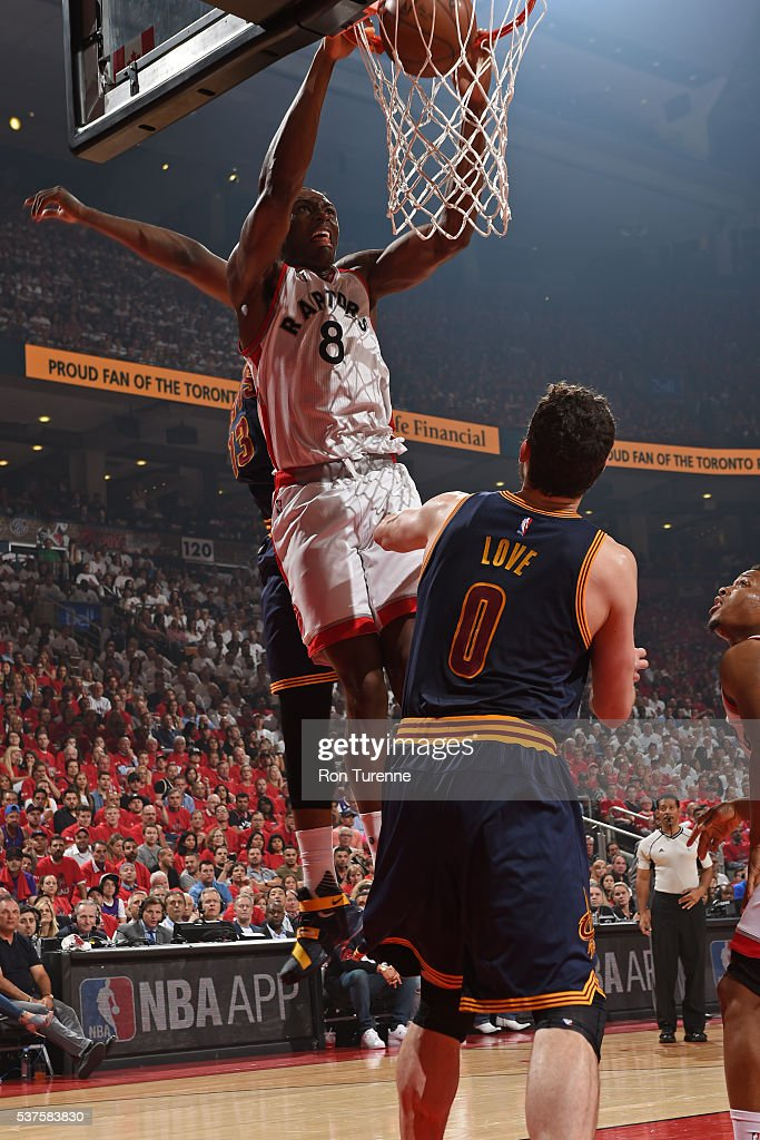 Bismack Biyombo of the Toronto Raptors dunks the ball against the Cleveland Cavaliers in Game Six of the NBA Eastern Conference Finals at Air Canada...
