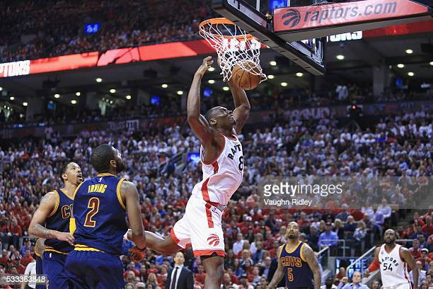 Bismack Biyombo of the Toronto Raptors dunks the ball during the second half against the Cleveland Cavaliers in game three of the Eastern Conference...