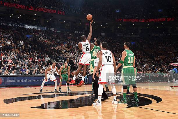Bismack Biyombo of the Toronto Raptors fights for the jump ball against Jae Crowder of the Boston Celtics during the game on March 18 2016 at the Air...