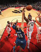 Bismack Biyombo of the Toronto Raptors goes to the basket against Nemanja Bjelica of the Minnesota Timberwolves on October 12 2015 at the Air Canada...
