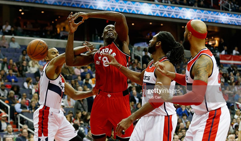 Bismack Biyombo #8 of the Toronto Raptors is fouled by Ramon Sessions #7 of the Washington Wizards in the first half at Verizon Center on January 8, 2016 in Washington, DC.