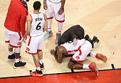 Bismack Biyombo of the Toronto Raptors reacts on the floor after the 4th quarter against the Cleveland Cavaliers in game three of the Eastern...
