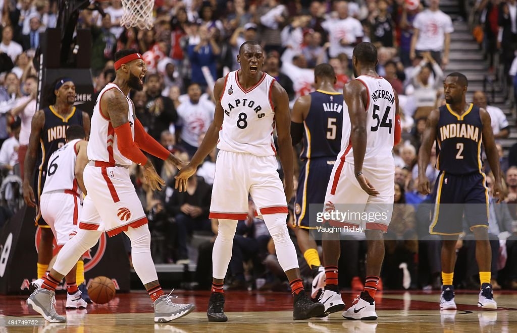 Bismack Biyombo #8 of the Toronto Raptors reacts to a call by the referee during the NBA season opener against the Indiana Pacers at Air Canada Centre on October 28, 2015 in Toronto, Ontario, Canada.