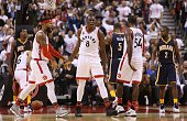 Bismack Biyombo of the Toronto Raptors reacts to a call by the referee during the NBA season opener against the Indiana Pacers at Air Canada Centre...