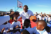 Bismack Biyombo of the Toronto Raptors shakes kids hands during the Boys Girls Club of Protea Glen court dedication as part the Basketball Without...