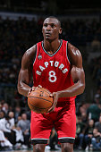 Bismack Biyombo of the Toronto Raptors shoots against the Milwaukee Bucks during the game on December 26 2015 at BMO Harris Bradley Center in...