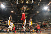 Bismack Biyombo of the Toronto Raptors shoots the ball against the Indiana Pacers on March 17 2016 at Bankers Life Fieldhouse in Indianapolis Indiana...