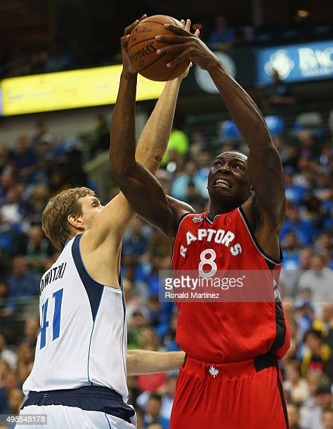 Bismack Biyombo of the Toronto Raptors takes a shot against Dirk Nowitzki of the Dallas Mavericks in the first half at American Airlines Center on...
