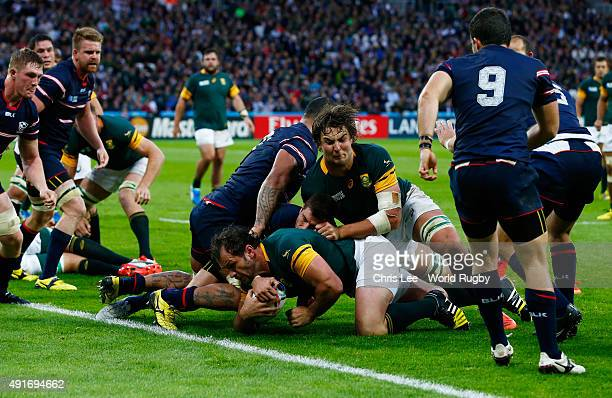Bismarck Du Plessis of South Africa scores a try during the 2015 Rugby World Cup Pool B match between South Africa and USA at the Olympic Stadium on...