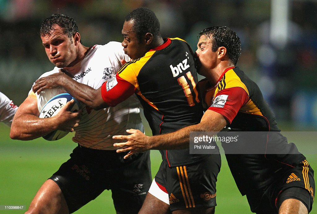 Bismarck du Plessis of the Sharks is tackled by Sitiveni Sivivatu and Richard Kahui of the Chiefs during the round five Super Rugby match between the Chiefs and the Sharks at Waikato Stadium on March 18, 2011 in Hamilton, New Zealand.