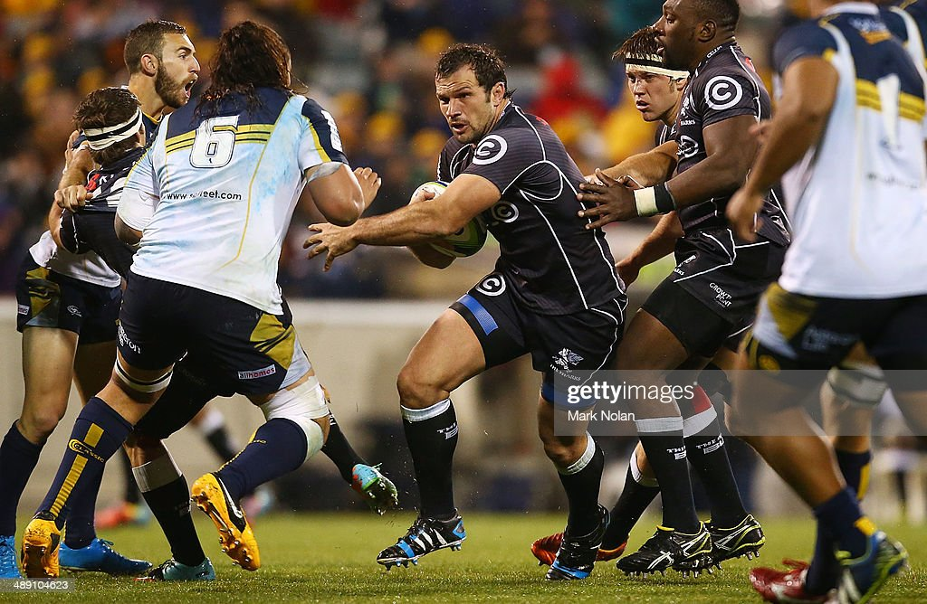 <a gi-track='captionPersonalityLinkClicked' href=/galleries/search?phrase=Bismarck+du+Plessis&family=editorial&specificpeople=636411 ng-click='$event.stopPropagation()'>Bismarck du Plessis</a> of the Sharks runs the ball during the round 13 Super Rugby match between the Brumbies and the Sharks at Canberra Stadium on May 10, 2014 in Canberra, Australia.