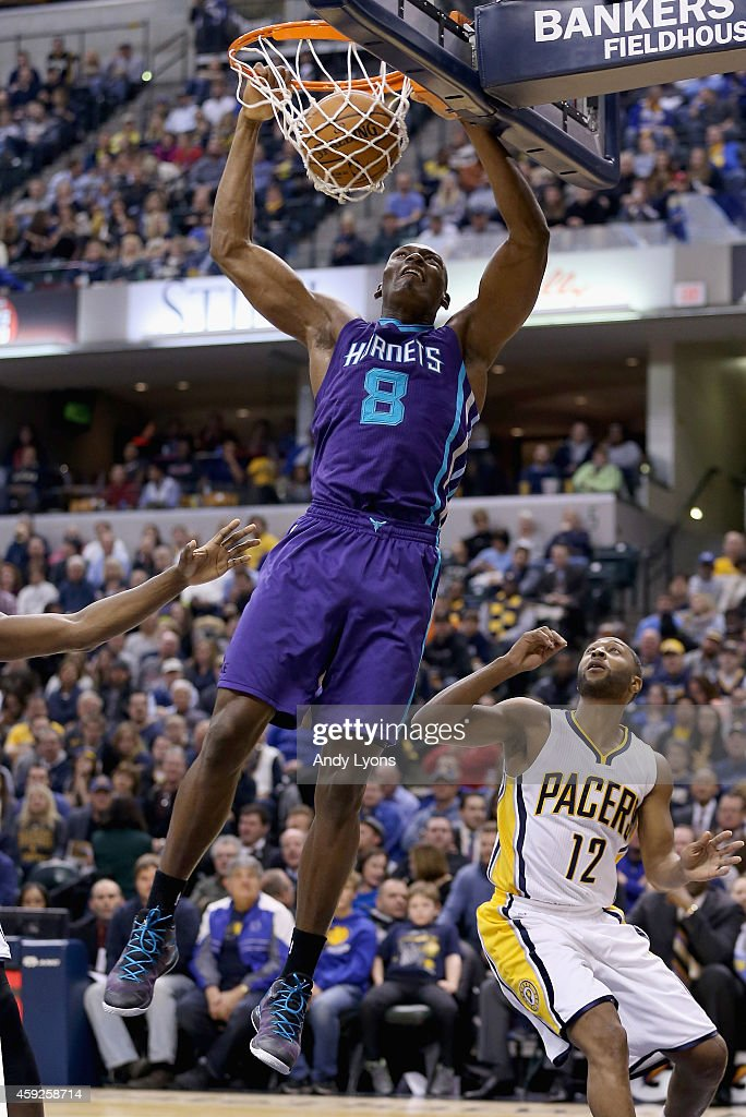 Bismark Biyombo of the Charlotte Hornets dunks the ball during the game against Indiana Pacers at Bankers Life Fieldhouse on November 19 2014 in...