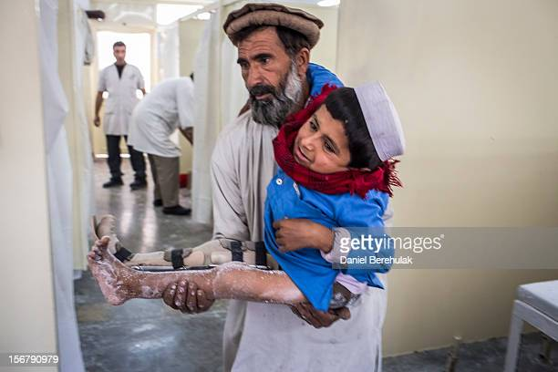 Bismillah Gul suffering from poliomyelitis is carried by his father Masta Gul after having travelled from Khost province to get treatment at the...
