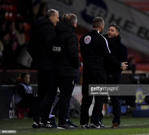 Bistol manager Lee Johnson and Sheffield United manager Chris Wilder exchange words during the Sky Bet Championship match between Sheffield United...