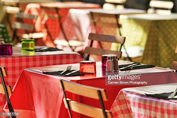 Bistro tables set for lunch in a provencal town