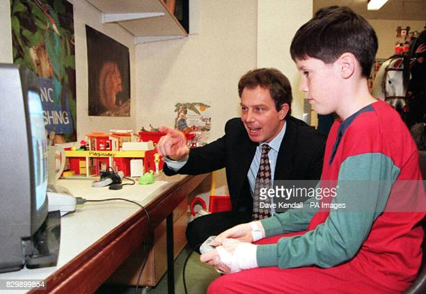 A bit of computer advice for young patient Luke McHale from Labour leader Tony Blair who was visting Arrowe Park Hospital Wirral as part of the by...
