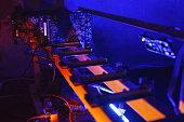 Homemade GPU bitcoin mining farm at night.