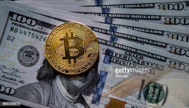Bitcoin physical tokens sit next to a collection of US dollar bills in this arranged photograph on 01 November 2017 in Hong Kong China The electronic...