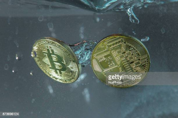 Bitcoin replica coins are seen on November 13 2017 The cryptocurrency plunged 15 percent in value over the weekend amidst problems with the...