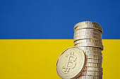 Bitcoin stack with a national flag in the background