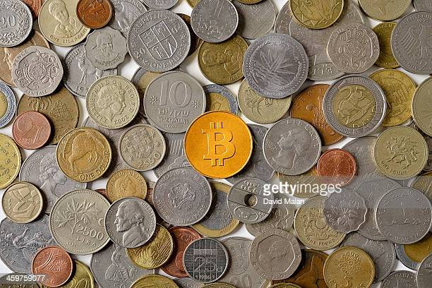 Bitcoin surrounded by various world coins