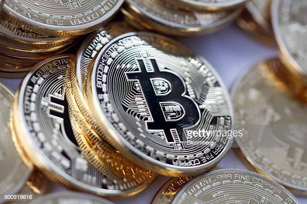 Bitcoins sit in a pile in this arranged photograph in Danbury UK on Thursday Dec 10 2015 Bitcoin the digital currency climbed on Wednesday to hit its...