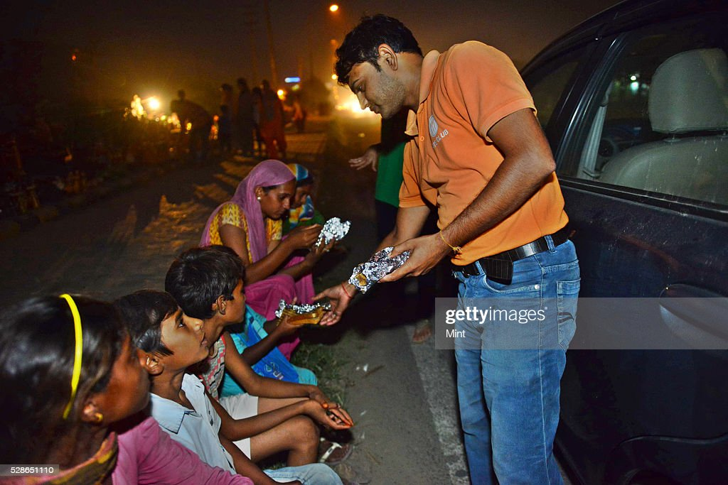 BiteClub distribiting food in slum in Gurgaon. They associate with other group Robin Hood Army on October 04, 2015 in New Delhi, India.