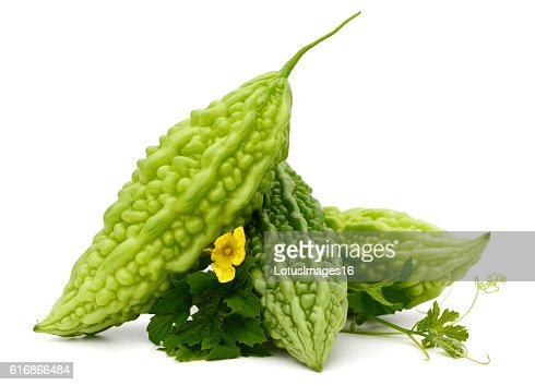 Bitter melon, Bitter gourd with leaves on white background : Stock Photo