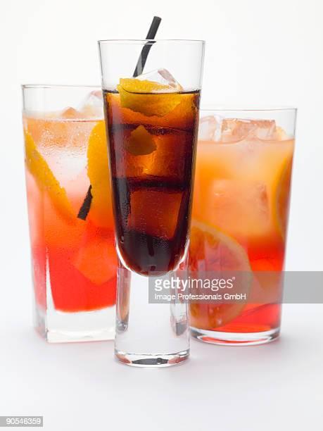 Bitter schnapps with ice cubes, Campari soda and Campari orange