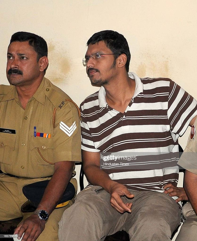 Bitti Mohanty (2nd from left) sitting under arrest at Transport Nagar Police Station on March 15, 2013 in Jaipur, India. Police Team from Kunnur district of Kerala visited Alwar jail and examined its record to verify the identity of Mohanty who was arrested in Kerala last week. Bitti Mohanty, son of Former Odisha DGP jumped parole in 2006 from Alwar jail after being convicted in German woman rape case.